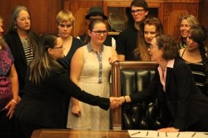 Nicole Stapp, OFYC member, shaking Governor Brown's hand.